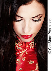 woman in red Cheongsam