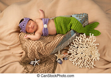 Newborn Baby in a Mermaid Costume - Newborn baby girl...