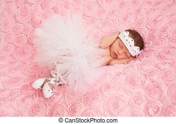 Newborn Baby Girl in White Tutu - Newborn baby girl wearing...