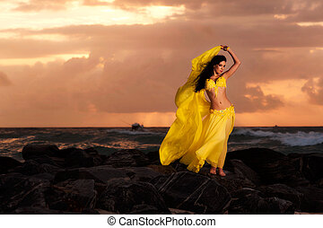 Belly Dancer in Yellow at the Beach - A beautiful...
