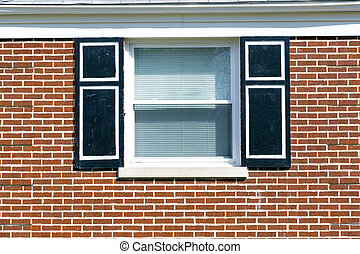Traditional window with wooden shutters.