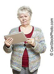 Senior woman using tablet computer looking confused on white...