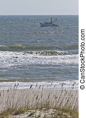 Fishing Choppy Waters - A fishing trawler out on a choppy...