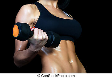 Beautiful brawny body of the woman with dumbbells -...