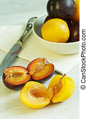 Two cuted plums - Two cuted different varieties of ripe...