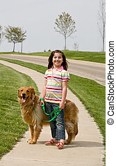 Girl with Dog - Girl Walking Down the Sidewalk With Dog