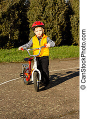 Adorable young boy posing with his bicycle - Adorable young...
