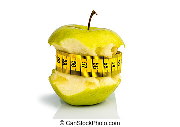 apple with measuring tape on - apple with a measuring tape...
