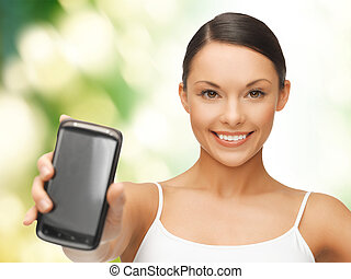woman showing smartphone - beautiful sporty woman showing...