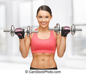 woman with dumbbells - picture of beautiful sporty woman...