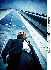 new opportunities - Young business man standing in the big...