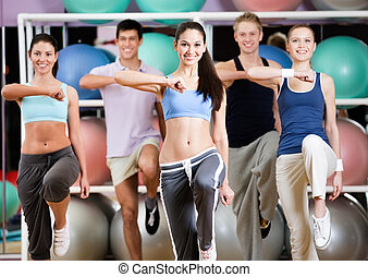 Group of athletic people at the gym