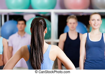 Group of people at the gym in a fitness class