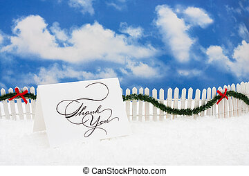 Happy Holidays - Thank you card sitting on snow with white...