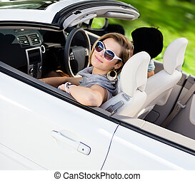 Smiley girl in the car with her friend - Smiley girl in the...