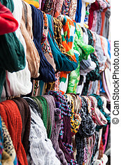 Colorful shawls and scarfs on market