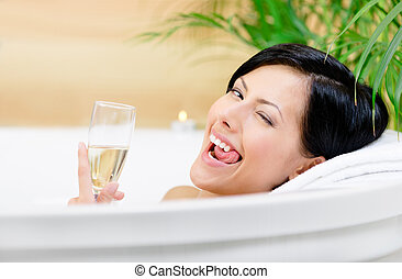 Girl taking a bath drinks alcoholic beverage - Woman taking...