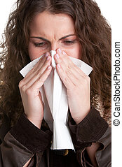 Sick Woman Sneezing - Pale sick woman with a flu, sneezing,...