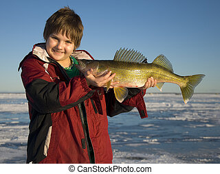 Boy with Walleye - Boy with a large Wallye caught ice...