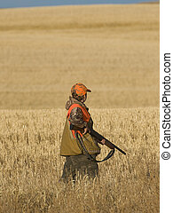 Boy Pheasant Hunting - Boy out Pheasant hunting in North...