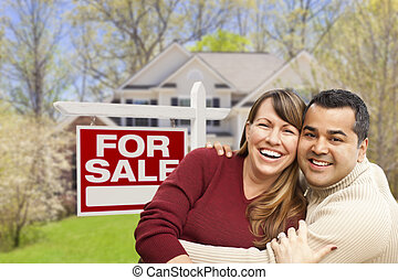 Couple in Front of For Sale Sign and House - Happy Couple in...