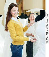 happy women chooses bridal gown - Two happy women chooses...