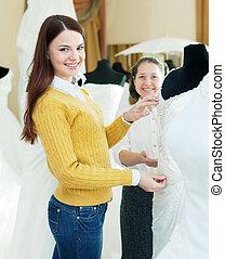 happy women chooses bridal gown - Two happy women chooses...