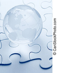 glass globe with puzzle background