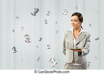 business woman holding a tablet - attractive business woman...