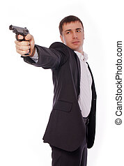 A man with a gun in his hand - Man posing james bond like...