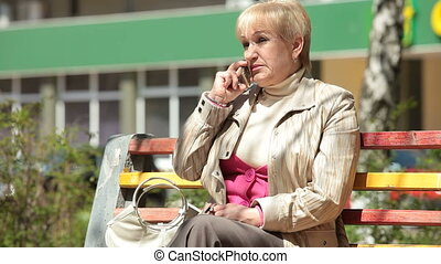 Cheerful Senior Woman On The Phone