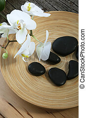 Spa massage stones and orchids
