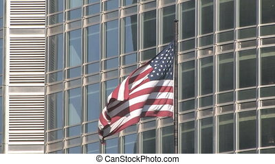 American Flag - An American flag waving in front of the...