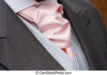 grooms cravat - close up of a pink cravat on groom