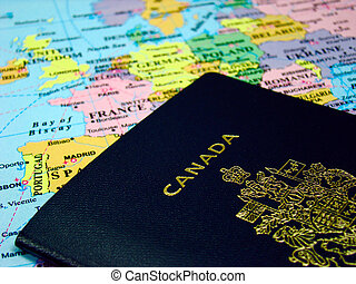 Canadian passport - Photo of a Canadian passport against map...