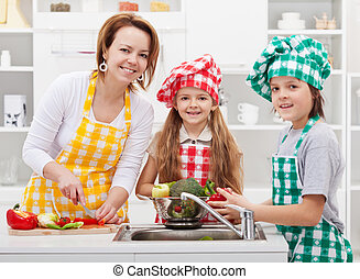 Kids helping mother in the kitchen - Kids helping mother...