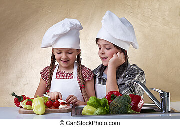 Kids cutting vegetables for a salad