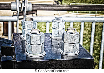 Four Bolts - Four sets of huge, strong bolts holding a newly...