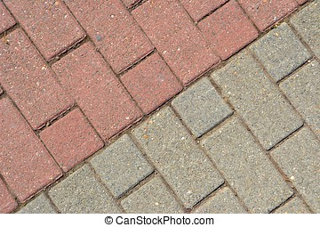 gray and red paving bricks on a walkway