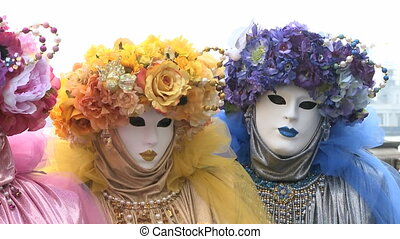 Four colorful Ladies - Four disguised women in colorful...
