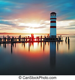 Ocean lighthouse sunset  - Ocean sunset with lighthouse