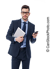 Handsome young businessman with a digital tablet and mobile...
