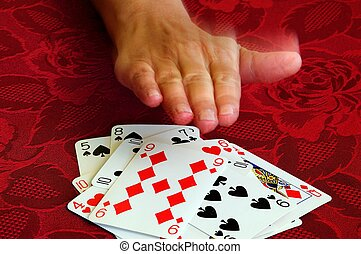 Playing card game of snap. - Hand rushing down onto cards...