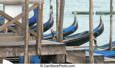 Gondolas in Venice - Empty gondolas in Venice at the...