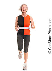 Active senior woman - Running senior woman in front of white...