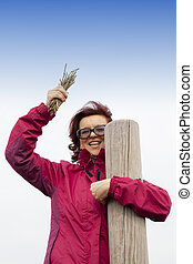 Smiling woman with wild asparagus