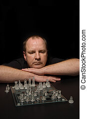 Chess Match - A man involved in a competative chess match.