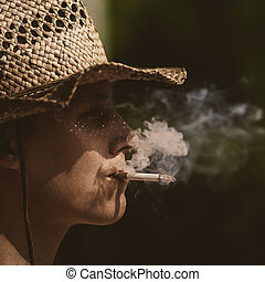 cowboy in hat with cigar silhouette