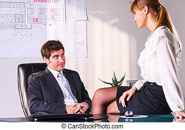 seducing a boss - businesswoman is seducing her boss at...