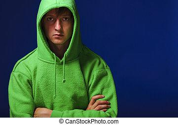 young man in green sweatshirt